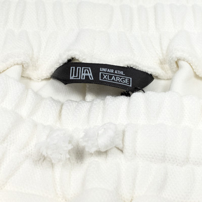 pique-tennis-t-Short-white-detail1.jpg
